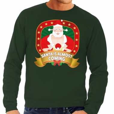 Foute kersttrui groen santa is almost coming voor man